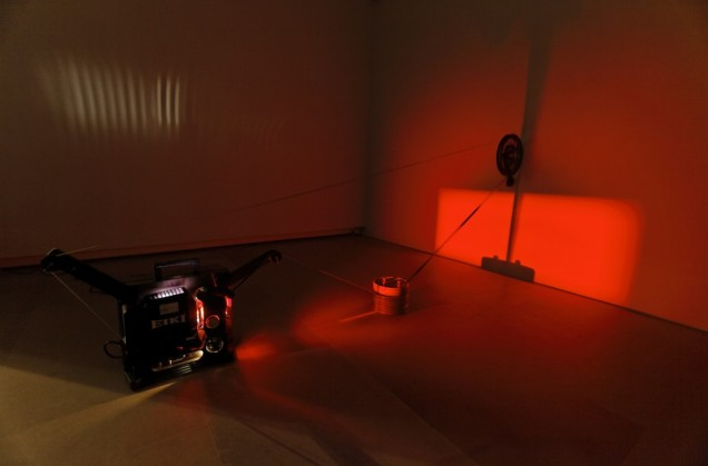 <em>Rosa Barba</em>, Boundaries of Consumption, 2012. 2 × metal globes, 16 mm projector, 16 mm film loop, film canisters. Courtesy of the artist